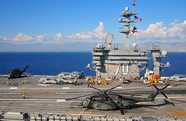 The aircraft carrier Carl Vinson is accompanied by the destroyer Wayne E. Meyer